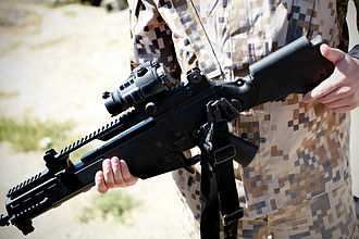Latvian Land Forces - A Latvian soldier demonstrates the Heckler & Koch G36 rifle