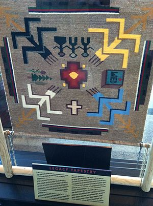 Catholic Health Initiatives - This Legacy Tapestry was created in 2010 by Lynda Teller Pete using Navajo symbols. The tapestry represents Catholic Health Initiatives' mission.