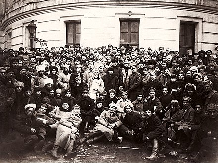 Vladimir Lenin, Kliment Voroshilov, Leon Trotsky and soldiers, Petrograd, 1921. Lenin, Trotsky and Voroshilov with Delegates of the 10th Congress of the Russian Communist Party (Bolsheviks).jpg