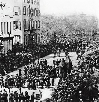 Theodore Roosevelt - Theodore and Elliot Roosevelt watch Abraham Lincoln's funeral procession passing their grandfather's mansion in New York City.