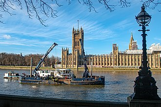 Port of London Authority - London Titan working opposite the Houses of Parliament