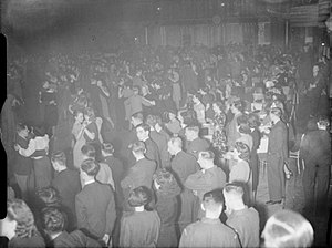 Hammersmith Palais - Despite the Blitz, soldiers, Royal Air Force personnel and civilians enjoy an evening of dancing at the Hammersmith Palais de Danse in the spring of 1941.