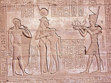 Egyptian relief depicting the Roman Emperor Trajan (right, reigned 98-117 AD) in full pharaonic style. Luxor.Aswan & Qena 10.JPG