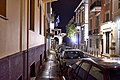 Lysikratous Street in Plaka. In the distance, the Arch of Hadrian and the Temple of Olympian Zeus.jpg