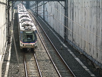 Manila Metro Rail Transit System - An MRT-3 train Tatra RT8D5M approaching Ayala station.