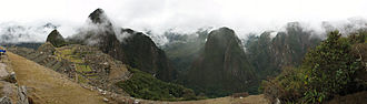 Environmental history - The city of Machu Picchu was constructed c. 1450 AD, at the height of the Inca Empire. It has commanding  views down two valleys and a nearly impassable mountain at its back. There is an ample supply of spring water and enough land for a plentiful food supply. The hillsides leading to it have been terraced to provide farmland for crops, reduce soil erosion, protect against landslides, and create steep slopes to discourage potential invaders.