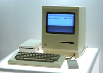The Macintosh, released in 1984, is the first mass-market personal computer to feature an integral graphical user interface and mouse. Macintosh, Google NY office computer museum cropped.png