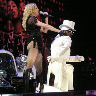"For the performance of ""Beat Goes On"" Pharrell Williams and Kanye West appeared on the backdrops Madonna Buenosaires.jpg"