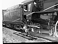 Man Sitting in the Cab of a Locomotive at Virginia(GN07486).jpg