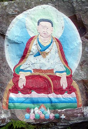 Marpa Lotsawa - A traditional depiction of Marpa painted on a rock on Holy Isle, Firth of Clyde