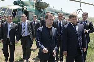 Adam Delimkhanov - Adam Delimkhanov (on the extreme right) with Dmitry Medvedev (front left) and Ramzan Kadyrov (front right)