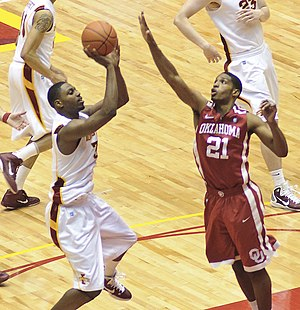 Melvin Ejim - Oklahoma's Cameron Clark attempts to block a shot by Melvin Ejim on January 29, 2011.