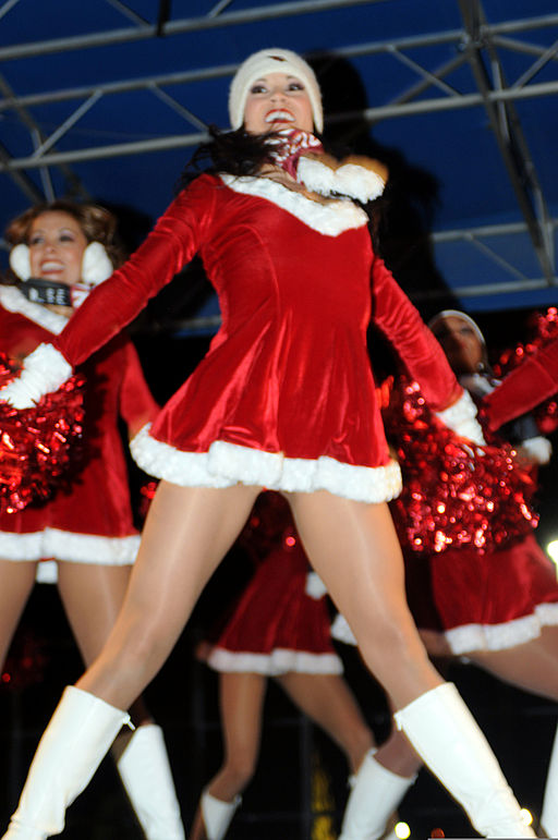 Members of the Arizona Cardinals cheerleading squad perform onstage outside Freedom Crossing, at Fort Bliss, Tex., Dec. 15, 2011 111215-A-KJ276-008