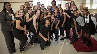 Pittsburgh Creative and Performing Arts School - First Lady Michelle Obama, Carla Bruni, wife of then French President Nicolas Sarkozy, and Marisa Leticia Lula da Silva, wife of then Brazilian President Luiz Inácio Lula da Silva, pose for a group photo after a performance by students of CAPA in September 2009.