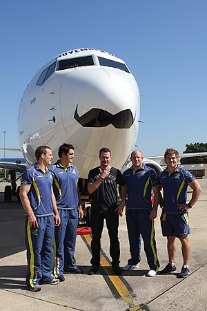 Movember - Members of the Australia national rugby union team sporting moustaches at the unveiling of a promotionally decorated Boeing 737-800 aircraft, during Movember in 2011