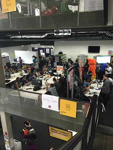 The photo is a view from a balcony at MozFest, giving a top-down view on  a workshop