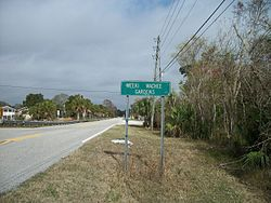 County Road 597 enters Weeki Wachee Gardens, Florida.