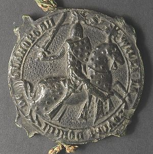 "Eleanor de Clare - 1329 seal of William la Zouche, 1st Baron Zouche of Mortimer (died 1337), jure uxoris Lord of Glamorgan, husband of Eleanor de Clare (1292–1337), daughter and eventual heiress of Gilbert de Clare, 6th Earl of Hertford, 7th Earl of Gloucester, Lord of Glamorgan and feudal baron of Gloucester. Inscribed: S(igillum) Will(elm)i La Zouche Domini De Glamorgan (""Seal of William la Zouche, Lord of Glamorgan""). His shield and the caparison of his horse show the Zouche arms bezantée"