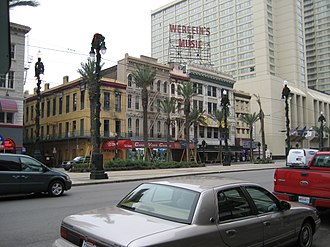 """P. P. Werlein - The former flagship Werlein Music Building in New Orleans now houses an upscale restaurant; the """"Werlein's For Music"""" sign atop the building remained, but it was replaced by the newer establishment's name prior to August 2014. Each of the words of the restaurant's name are now displayed in neon lights: one green and one yellow."""