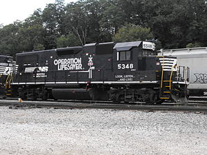"Regenerative brake - The box extending sideways from the roof directly over the word ""operation"" allows air to freely flow through the resistors of the dynamic brakes on this diesel-electric locomotive."