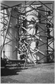 NYA-Oregon-men standing on scaffolding set around cylindrical structures being constructed - NARA - 196046.tif