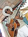 Nama man plays guitar.jpg