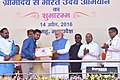 """Narendra Modi presenting the credit certificates, under various schemes to the beneficiaries from Scheduled Casts, at the launching ceremony of the """"Gram Uday se Bharat Uday"""" Abhiyan, in Mhow, Madhya Pradesh (6).jpg"""