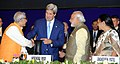 Narendra Modi with the US Secretary of State, Mr. John Kerry, at the 7th Vibrant Gujarat Global Summit 2015, in Gandhinagar, Gujarat. The Governor of Gujarat, Shri O.P. Kohli and the Chief Minister of Gujarat.jpg