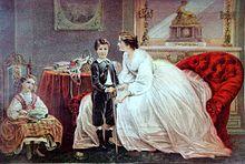 tableau représentant deux enfants, une fille assise et un garçon debout, et leur mère assise dans un fauteuil rouge.