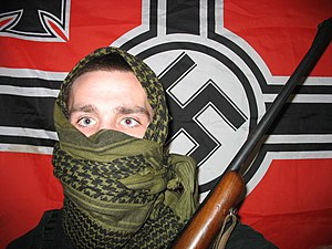 A militant neo nazi in USA holding a 30-.06 rifle.
