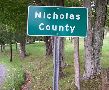A highway sign designating the border between Nicholas and Greenbrier counties in West Virginia along a secondary road NicholasCountySignWV.jpg