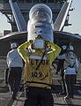 Nimitz Sailor directs Hornet onto catapult 141104-N-IP743-093.jpg