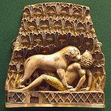 Square, yellow plaque showing a lion biting in the neck of a man lying on his back