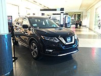Nissan Rogue 2017 CUV Hybrid Side Front.jpg
