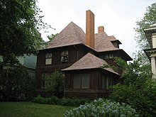 Exterior view of the Geoarge W. Smith house from right front corner to demonstrate a similar porch design and main house massing to the Hills House. The Smith house has the same roof, but its eaves are shallower and flared ends are less pronounced.