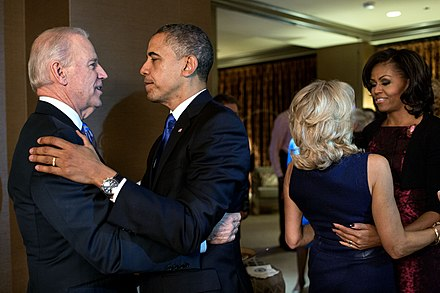 Obama (far right) celebrates with Jill Biden after their husbands win re-election. Obamas and Bidens on presidential election night 2012.jpg
