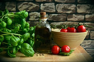The Albanian cuisine from the Mediterranean, which is characterised by the use of fruits, vegetables and olive oil, contributes to the good nutrition of the country's population. Olive-oil-1412361 1920.jpg