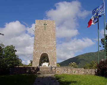 Memorial to the victims of the Sant'Anna di Stazzema massacre, in which 560 locals were murdered by Nazi Germans in 1944 Ossario sant anna di stazzema.jpg