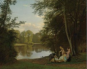 Quiet summer evening at a lake in the forest. Young women are washing clothes in Bondedammen in Hellebaek