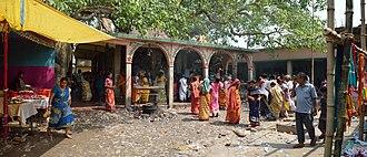 Gajan (festival) - Gajan devotees and spectators are assembled at the Panchananda mandir at village Narna, Howrah on 14 April 2014.