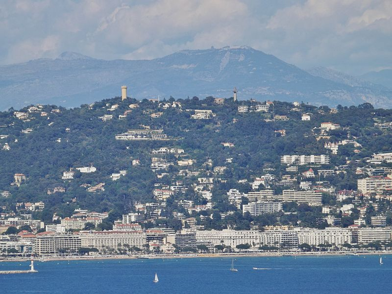 Panoramic sight, from Théoule-sur-Mer, of the Croisette boulevard and heights of Cannes, with visible the Intercontinental Carlton, Miramar and Martinez hostel palaces, in Alpes-Maritimes, France.