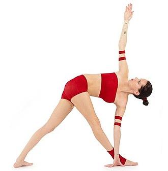 Trikonasana - Image: Parivrtta Trikonasana Yoga Asana Nina Mel