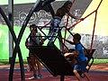 Park Scene with Kids on Swing - Dnipropetrovsk - Ukraine (44154608061).jpg