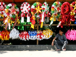 Christmas in the Philippines -  Paról (Christmas lanterns) being sold, during the Christmas season, in the Philippines. The paról is one of the most iconic and beloved symbols, of the Filipino holiday observance.