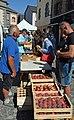 Peach vendor in Saint-Flour, Cantal.jpg