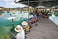 People fish for prawns on a bridge at Huka Prawn Park.jpg