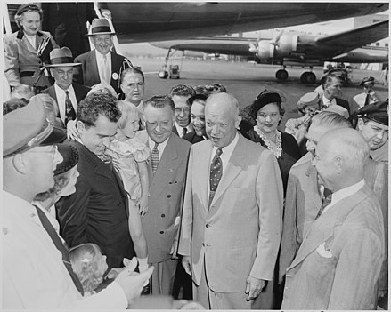 Richard and Pat Nixon introduce General Dwight D. Eisenhower--Richard Nixon's running mate--to their daughters Tricia (standing) and Julie (carried by her father), Washington National Airport, September 10, 1952. Photograph of General Dwight D. Eisenhower, the Republican nominee for President, at Washington National Airport with... - NARA - 200395.jpg