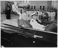 Photograph of President Truman doffing his hat to spectators as he rides in a limousine from the airport at Boca... - NARA - 200515.tif