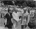 Photograph of President Truman shaking hands with General Dwight D. Eisenhower after decorating him with the... - NARA - 199120.tif