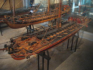 Pojama - Contemporary model of Brynhilda (built in 1776) at the Maritime Museum in Stockholm. The model is flying the blue three-tongued flag of the archipelago fleet from the stern.